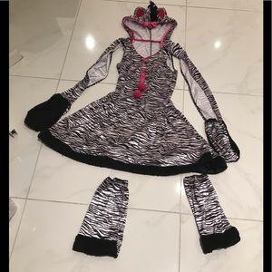 Young girl zebra costume.